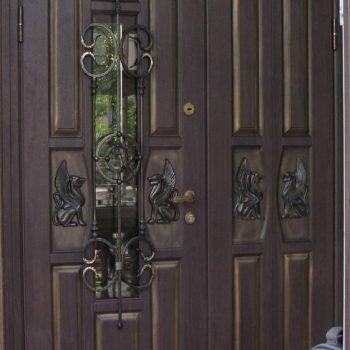 10 Входная дверь в коттедж + кованные элементы + стеклопакет + нестандарт